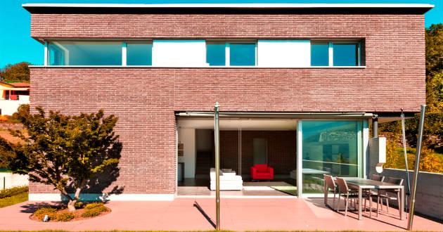 Fachadas de casas modernas revista lamudi for Casas modernas ladrillo